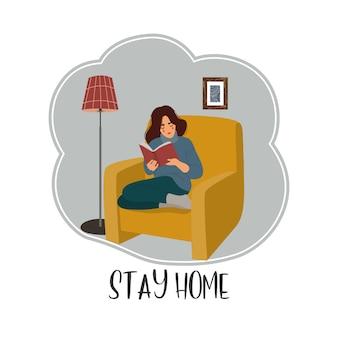 여자는의 자에 앉아 격리에서 아파트에서 책을 읽고.