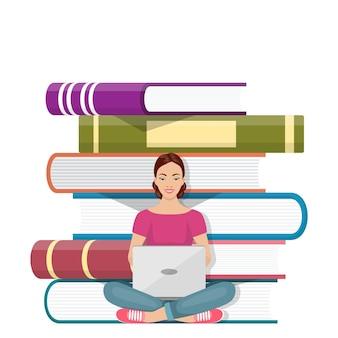 노트북으로 책 더미 앞에 앉아 있는 소녀