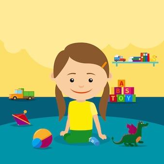 Девочка сидит на полу с игрушками