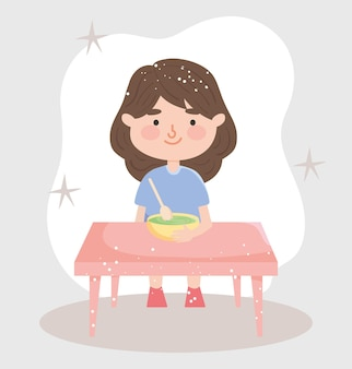 Girl sitting at the table eating