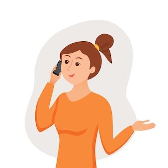 Девушка разговаривает, используя свой смартфон, держа в руке