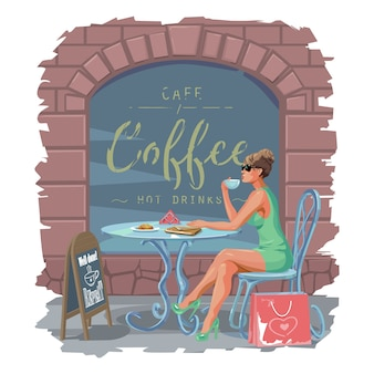 A girl in a summer cafe drinks coffee.