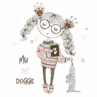 Girl in a sweater playing with a dog the dachshund.