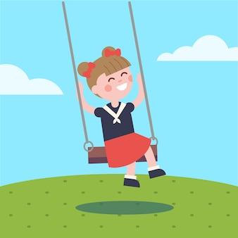 Девочка качается на веревке качели