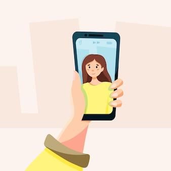 Девушка делает селфи по телефону