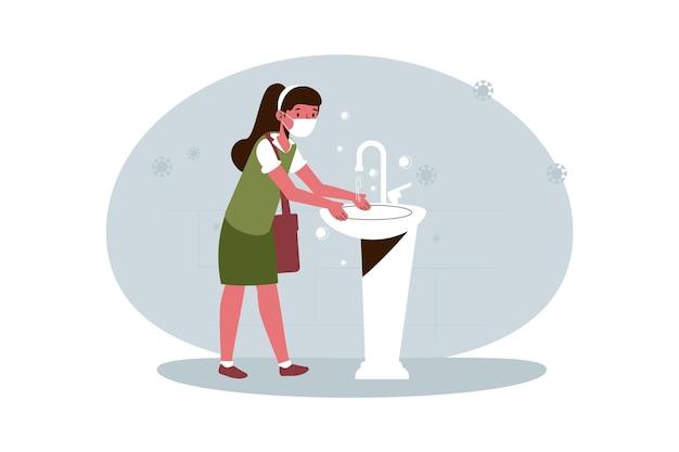 学校で手を洗う女の子
