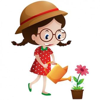 Девочка поливать цветок
