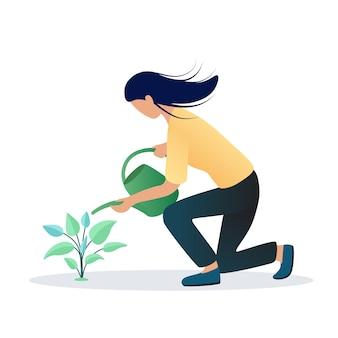 植物に水をまく少女。ガーデニング、植物学のコンセプト。