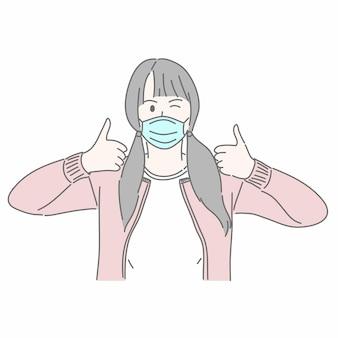 Девушка в медицинской маске и жесты поднимает палец вверх.