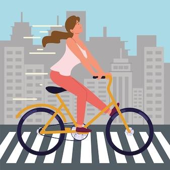 横断歩道の街で自転車を持つ少女