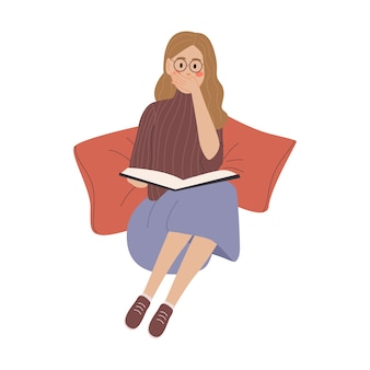 The girl with book on the floor and with pillows