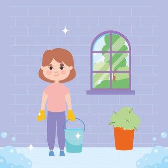 窓の前でバケツ掃除をしている女の子
