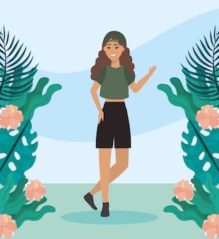 캐주얼 옷과 가지 식물을 가진 소녀