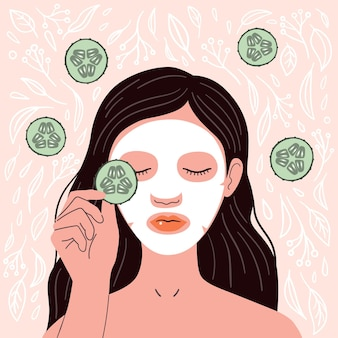 Girl with a cosmetic face mask with cucumber on her eyes