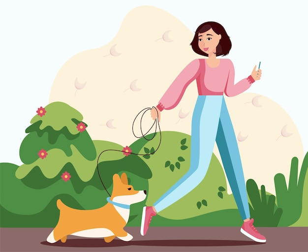 A girl with a dog walks in the park
