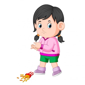 A girl with her potatoes fries fall down on the floor