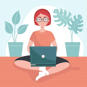 Girl with a laptop sits on the floor. concept of freelance, job at home. stay at home.
