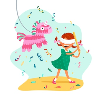 A girl with pigtails hits a pinata in the form of a unicorn