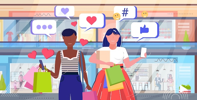 Girls couple using online mobile app social media network chat bubble communication digital addiction concept mix race women carrying paper bags shopping mall interior sketch portrait horizontal
