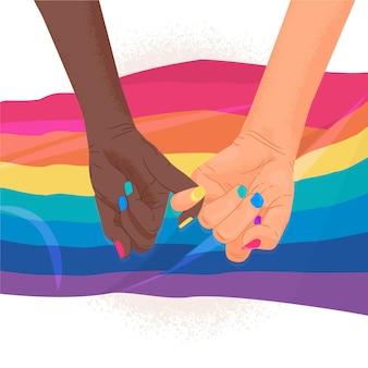 Девушки держатся за руки в день гордости