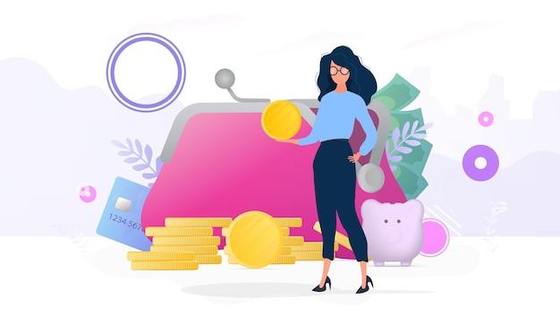 女の子は金貨を持っています。コイン、クレジットカード、ドルの山。貯蓄とお金の蓄積の概念。プレゼンテーションやビジネス関連の記事に適しています。