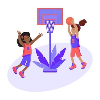 女の子がボールでバスケットボールをする