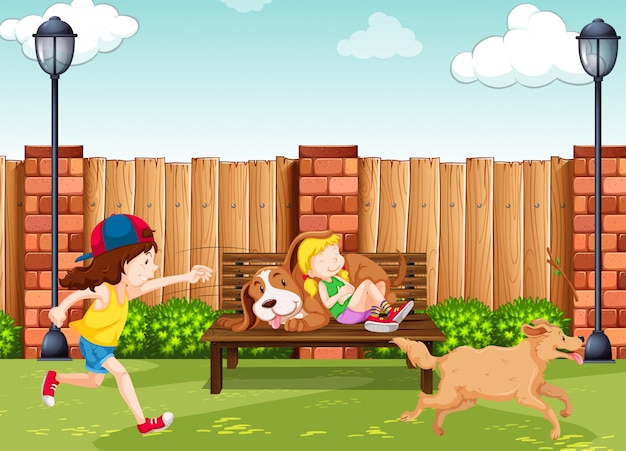 Girls playing with dogs in park