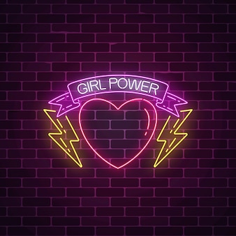 Girls power sign in neon style. glowing symbol of female slogan in ribbon with heart