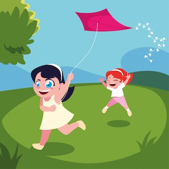 Girls smiling and playing with a kite on landscape