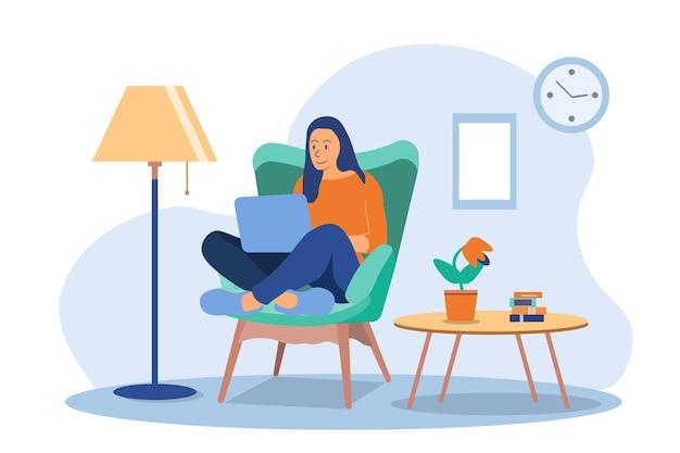 집에서 일하는 여자. 의자에 앉아 노트북을 사용하는 젊은 여자