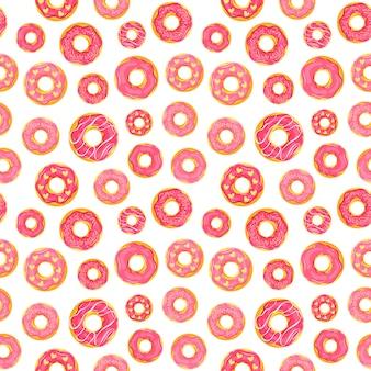 ピンク色の艶をかけられたドーナツと乙女チックなシームレスパターン。
