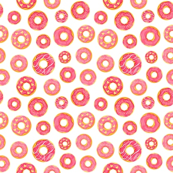 Girly seamless pattern with glazed donuts in pink colors.