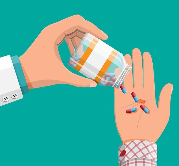 医者の手で病気や痛みの治療のためのカプセルのガラス瓶。