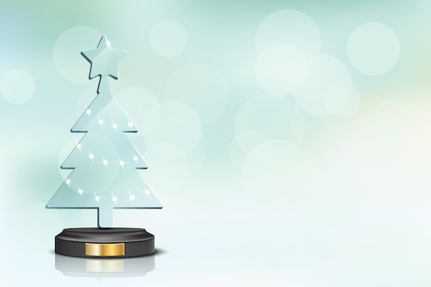 Glass christmas tree on blurred winter holiday background