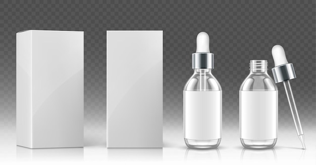 Glass dropper bottle for cosmetic oil or serum and white package box in front and angle view