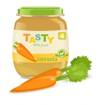 Glass jar with carrot baby food or puree.