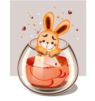 リンゴとウサギを注入した水のガラス