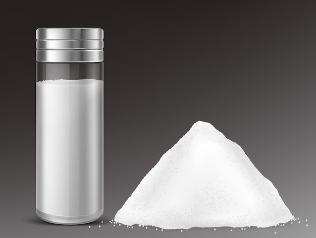 Glass salt shaker and pile of salt