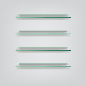 Glass shelves isolated on grey background.