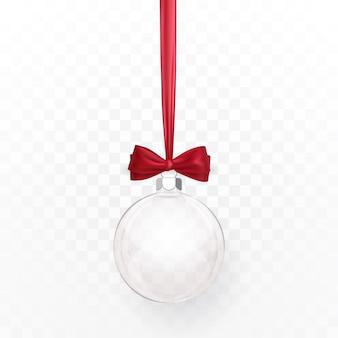 赤い弓とガラスの透明なクリスマスボール。白い背景の上のクリスマスのガラス玉。休日の装飾テンプレート。