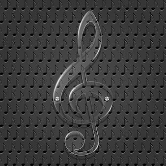 Стеклянный скрипичный ключ на фоне текстуры металла.