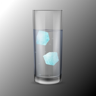 Glass with alcohol or water and two ice cubes