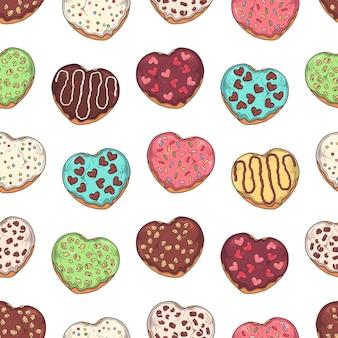 유약 도넛은 토핑, 초콜릿, 견과류로 장식되어 있습니다.