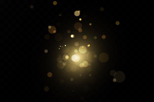 Эффект блеска частиц. золото сверкает. сверкающие частицы звездной пыли на прозрачном фоне. illustration.magic.