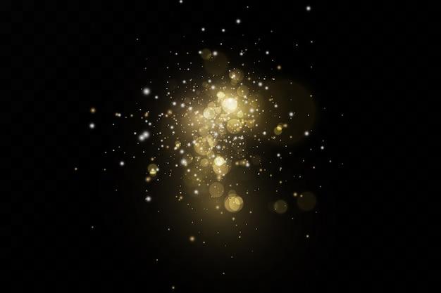 Эффект блеска частиц. золото сверкает. сверкающие частицы звездной пыли на прозрачном фоне.