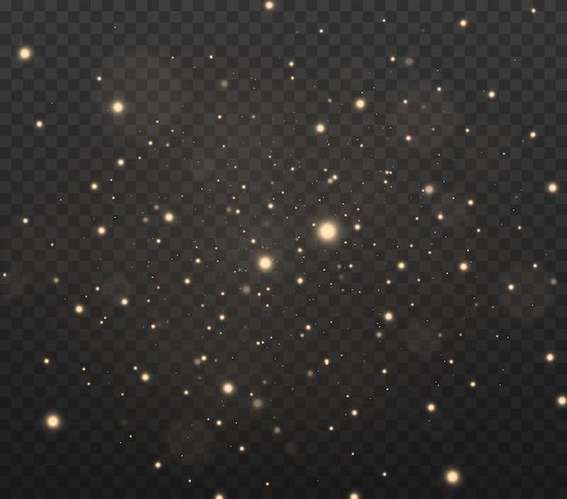 입자의 반짝이는 효과 먼지 스파크와 황금빛 별이 특별한 빛으로 빛납니다.
