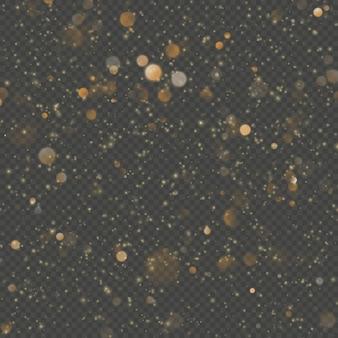 キラキラ粒子のオーバーレイ効果。透明な背景にゴールドのきらびやかなスターダスト輝く粒子。