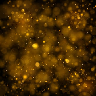 Glitter and sparkling magical dust particles with bokeh effect.