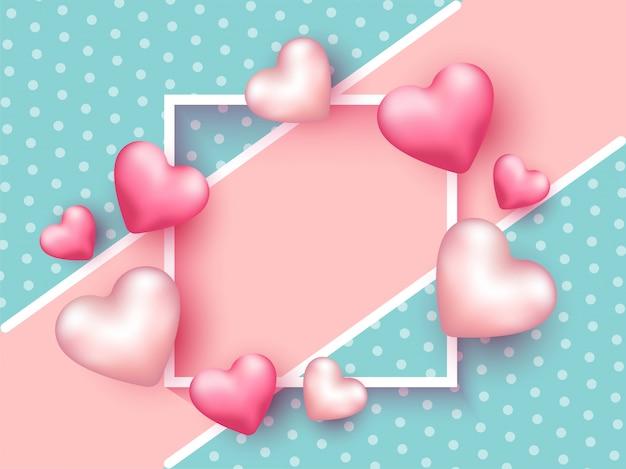 光沢のあるピンクの心は、ターコイズブルーの水玉の背景に空の正方形のフレームを装飾されています。