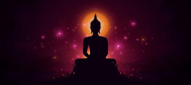 Светящаяся статуя будды на темном фоне